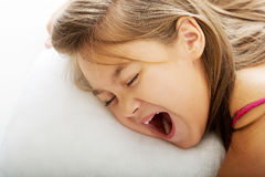 Young girl yawning while waking up Royalty Free Stock Images