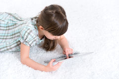 Child playing with digital tablet Royalty Free Stock Image