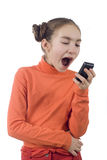 Young girl yelling into cellphone. Isolated over white Royalty Free Stock Photo
