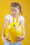 Young girl on yellow background Royalty Free Stock Image