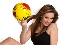 Young girl with a yellow ball Royalty Free Stock Photos