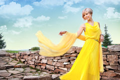 A young girl in a yellow dress Stock Image