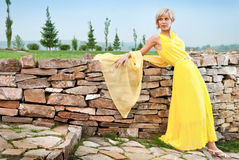 A young girl in a yellow dress Royalty Free Stock Photos