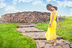 A young girl in a yellow dress Royalty Free Stock Images