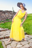 A young girl in a yellow dress Royalty Free Stock Photography