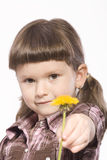 Young girl with yellow flower Stock Image