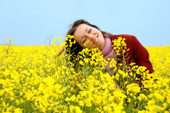 The young girl and yellow flowers Stock Images