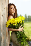 Young girl with yellow flowers Stock Photo