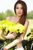 Young girl with yellow flowers Royalty Free Stock Photo