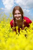 Young girl in yellow flowers royalty free stock photos