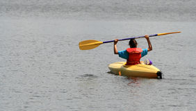 Young Girl in Yellow Kayak Royalty Free Stock Photo