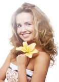 Young girl with yellow lily laughs Royalty Free Stock Photos