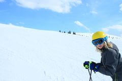 Young girl with yellow ski helmet Royalty Free Stock Photography