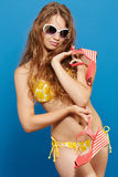 Young girl in yellow swimsuit Royalty Free Stock Photography