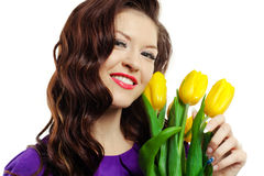 Young girl with yellow tulips Royalty Free Stock Photos