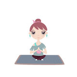 Young girl in a yoga pose on a mat Royalty Free Stock Image