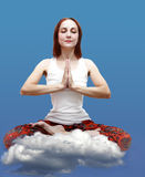 Young girl yogi meditates in the lotus position, stock photo