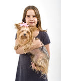 Young girl with a yorkshire terrier. Young girl  holding a yorkshire terrier dog isolated on white Royalty Free Stock Photo
