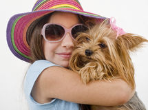 Young girl with a yorkshire terrier royalty free stock photos