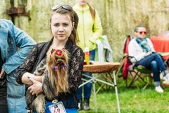 Young girl with a yorkshire terrier on her hands. Gomel, Belarus royalty free stock photos