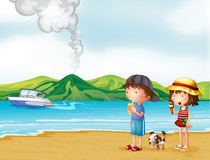 A young girl and a young boy strolling at the beach Stock Image