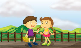 A young girl and a young boy at the wooden bridge Royalty Free Stock Images