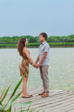 Young girl and the young man on the dock by the river. Girl and the young men on the dock by the river stock photography