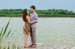 Young girl and the young man on the dock by the river Royalty Free Stock Images