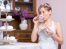 Young girld in a retro style wedding dress near a cupboard Stock Image