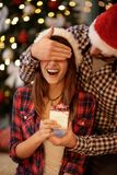Girlfriend has Christmas surprise Royalty Free Stock Photography