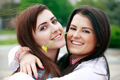 Young girlfriends have fun in park Royalty Free Stock Images