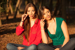 Young girlfriends playing on a park royalty free stock photography