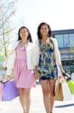 Young girlfriends shopping Stock Photos