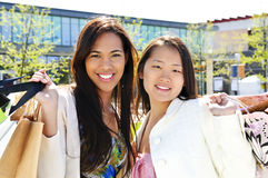 Young girlfriends shopping Royalty Free Stock Photo