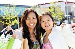 Young girlfriends shopping Stock Photography