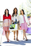 Young girlfriends shopping Stock Images