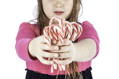 Young girlg holding candy canes Royalty Free Stock Images