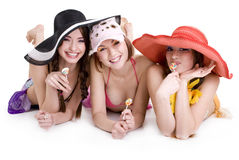 Young girls. Three young girls in their beach clothes with cocktails Royalty Free Stock Image