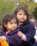 Young Girls. Kids (sister and younger sister) played together at playground Royalty Free Stock Images