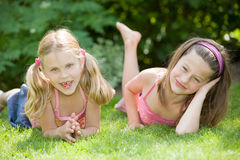 Young girls. Cute young girls on a summer's day lying in the grass Stock Photography