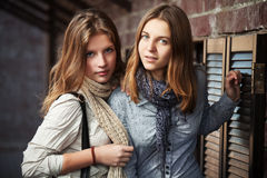Young girls against a wall Royalty Free Stock Image