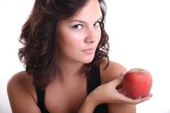 Young girls with an apple. Young girl with an apple in her hand Stock Images