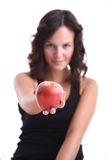 Young girls with an apple. Young girl with an apple in her hand Royalty Free Stock Photos