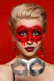 Young girls with appliance make-up in the style of Halloween. In the studio on a red background stock images