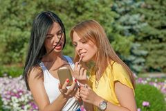 Young Girls Applying Make up Royalty Free Stock Photography