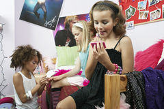Young Girls Applying Makeup In Bedroom Stock Images