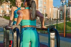 Girl is engaged in fitness at the sports grounds stock image
