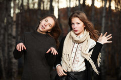 Young girls in autumn forest Stock Images