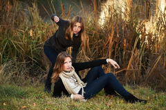 Young girls in an autumn park Stock Photo