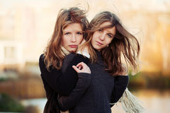 Two happy young fashion girls outdoor Royalty Free Stock Photo